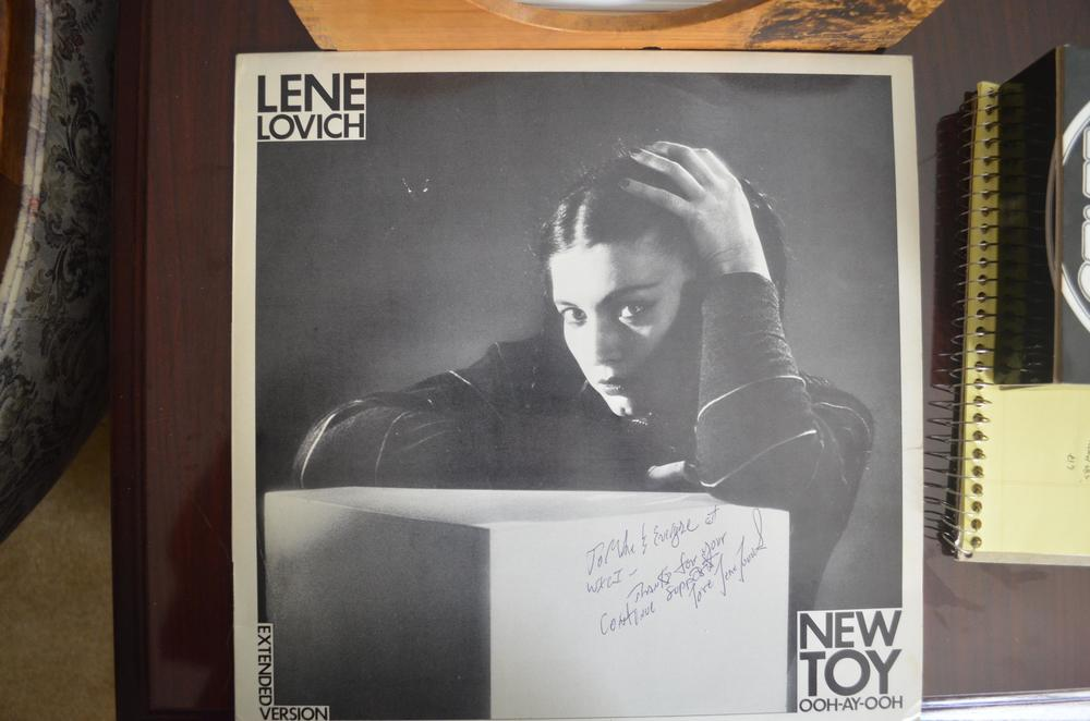 """Catalog # BUYIT97 is an extended version single on a full-size disc of Lovich and Dolby's """"New Toy"""" backed with a B-side song. We're not big on autographs here at the Dalenberg Library, but Lene herself signed this one for a now-defunct radio station 30 years ago."""
