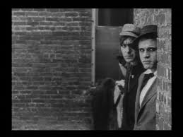 1912.  The Musketeers of Pig Alley.  Directed by D. W. Griffith.